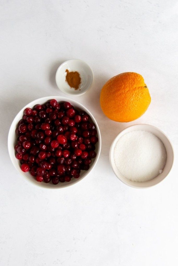 Ingredients for recipe in white bowls on a white background