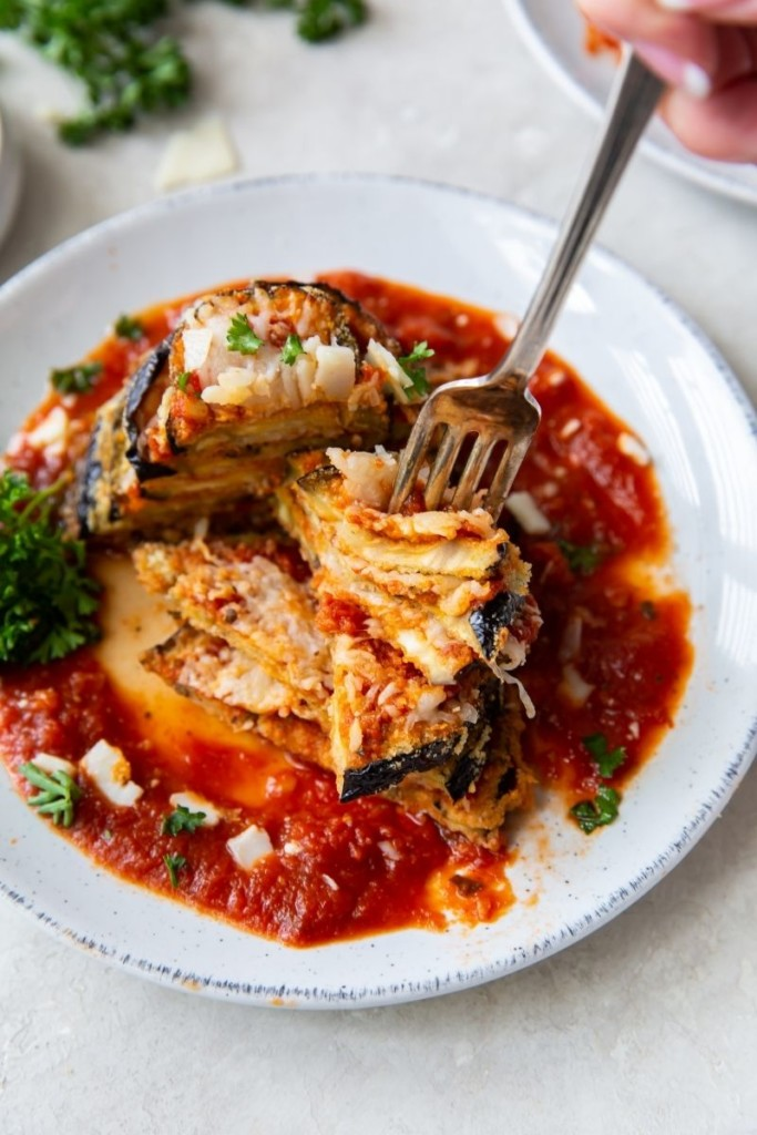 Stacked eggplant cutlets on a plate with a