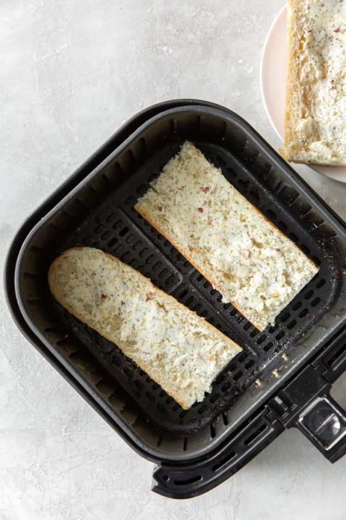 Uncooked garlic bread in air fryer