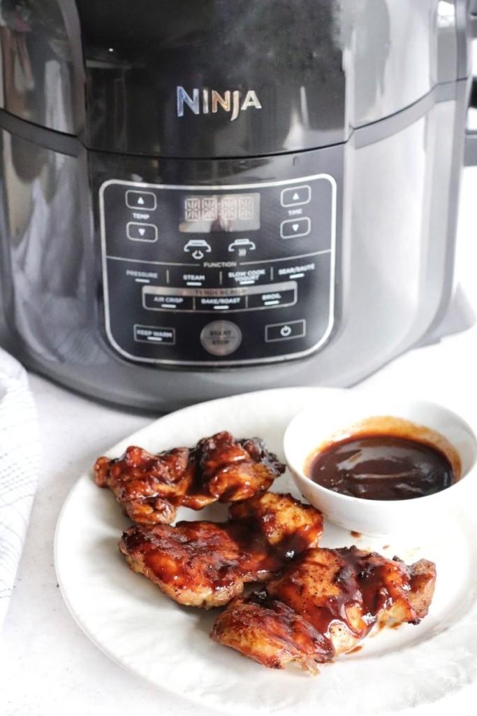 Chicken thighs in front of the Ninja air fryer machine