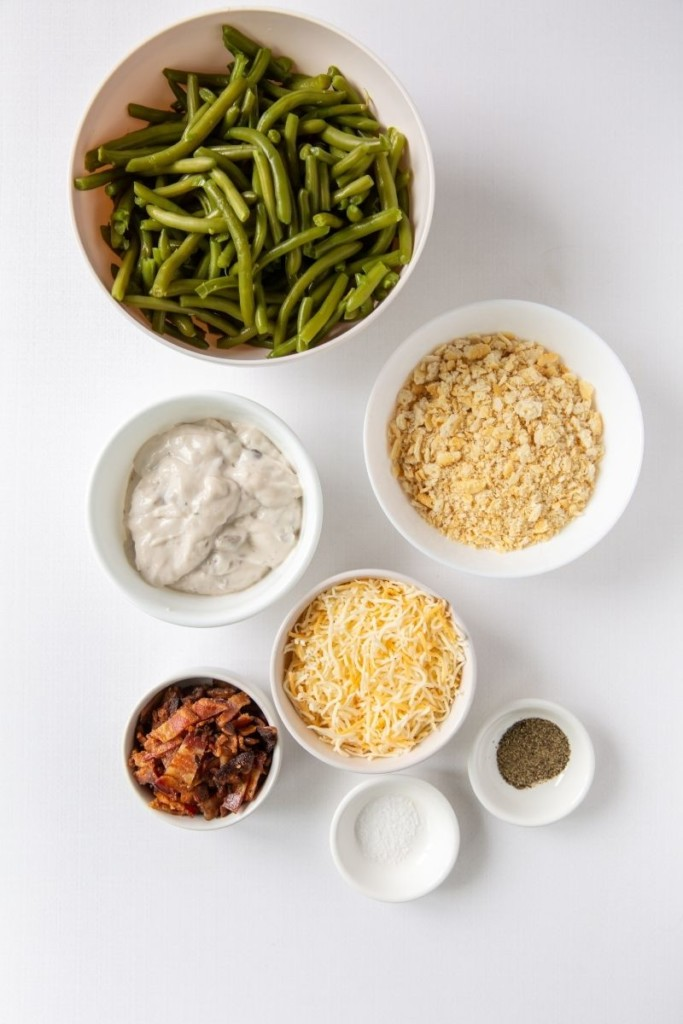 Ingredients to make Green Bean Casserole in small white bowls
