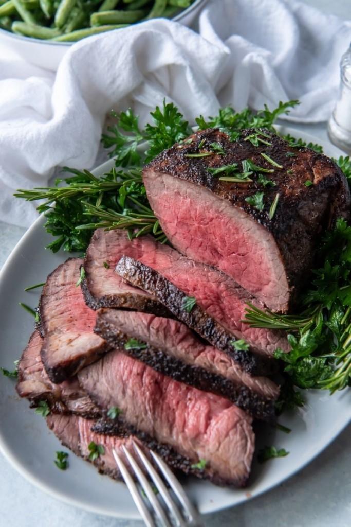 Roast beef on a serving platter sliced