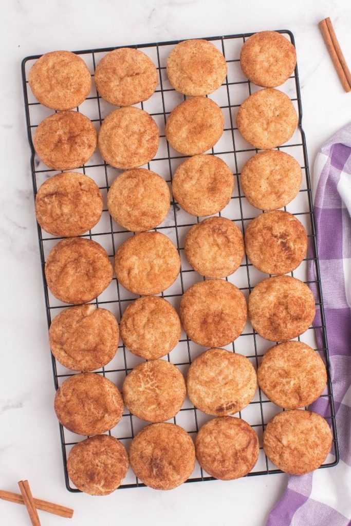 Snickerdoodle cookies on a cooling tray