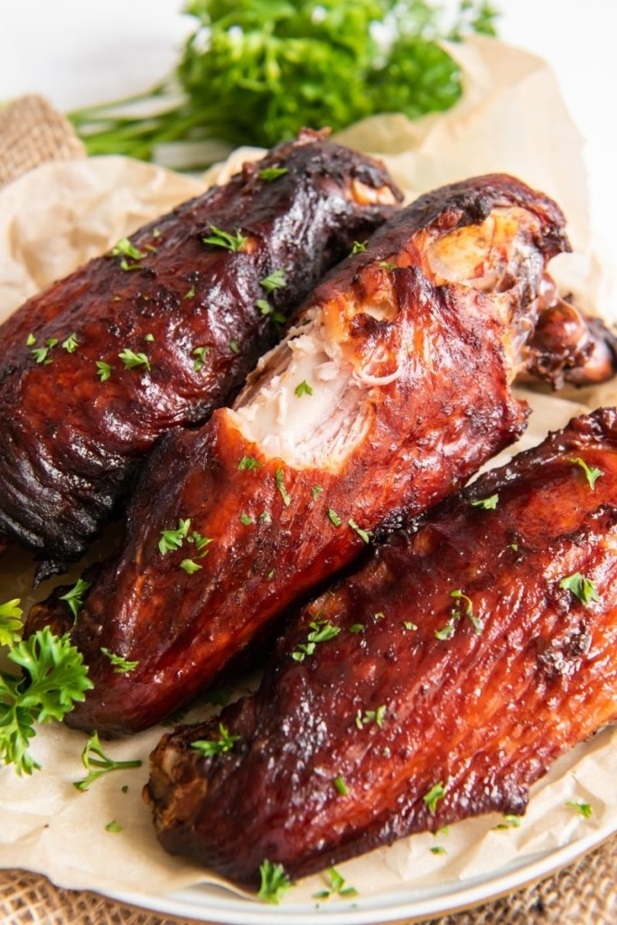 Air fryer smoked turkey wings with a bite taken out of one of the wings