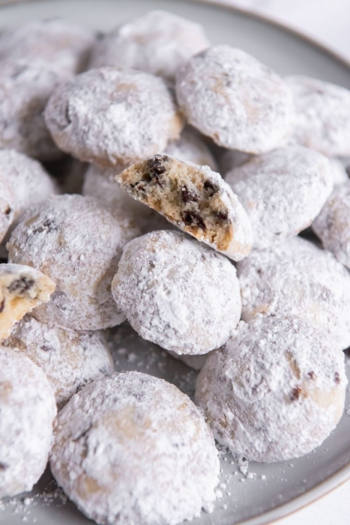 Snowball Cookies with Chocolate chips served on a grey round plate
