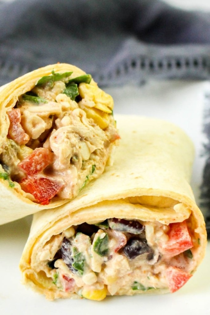 Chicken wrap halves on top of a white plate