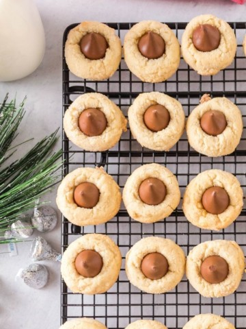 Hershey Kiss Shortbread Cookies lined on a wire cooling rack
