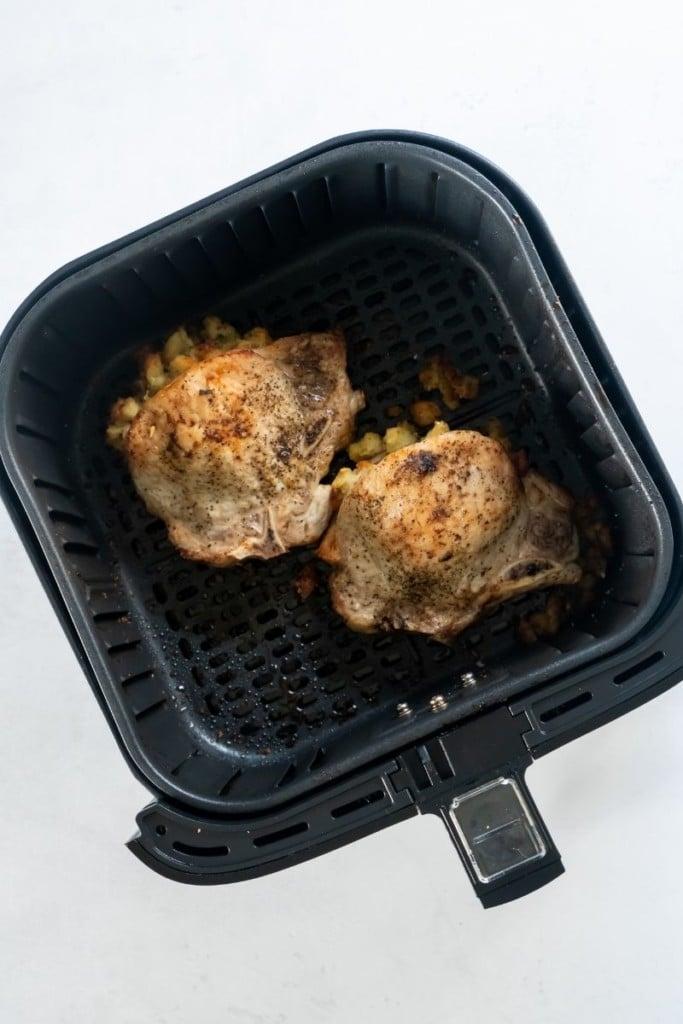 Cooked stuffed pork chops in air fryer basket